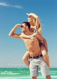 Couple having fun on the beach Stock Photo