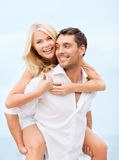 Couple having fun on the beach Royalty Free Stock Photography