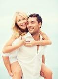 Couple having fun on the beach Stock Photos