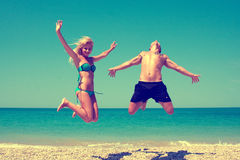 Couple having fun on the beach Royalty Free Stock Photography