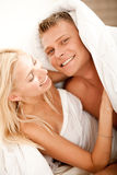 Couple having fun in bed Royalty Free Stock Photo