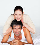 Couple having fun in bed looking at the camera Stock Photos