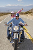 Couple Having Fun On A Bike Ride Royalty Free Stock Photo