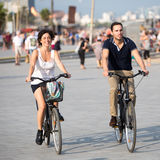 Couple having fun on bikes Royalty Free Stock Image