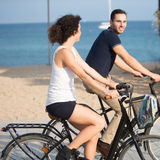 Couple having fun on bikes Royalty Free Stock Photo