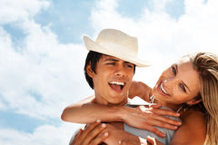 Couple having fun with the blue sky Royalty Free Stock Photography