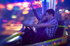Couple having fun in bumper car Royalty Free Stock Photography