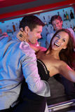 Couple Having Fun In Busy Bar Royalty Free Stock Photography