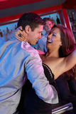 Couple Having Fun In Busy Bar. Couple Having Fun Dancing In Busy Bar royalty free stock photo