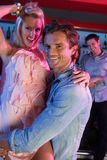 Couple Having Fun In Busy Bar. Couple Having Fun Together In Busy Bar royalty free stock image