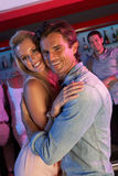 Couple Having Fun In Busy Bar royalty free stock photos