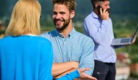 Couple having fun while busy businessman speak on phone. Couple happy flirting while man tense with mobile conversation. Couple having fun while busy businessman Royalty Free Stock Photo