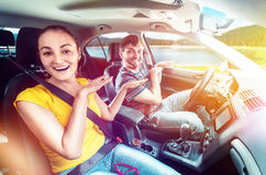 Couple having fun in the car Royalty Free Stock Images