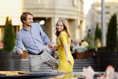 Couple having fun in a city Stock Images