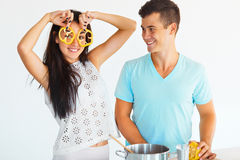 Couple having fun while cooking in the kitchen. Stock Image