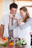 Couple having fun cooking together Stock Image