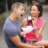 Couple having fun with cotton candy floss Royalty Free Stock Images