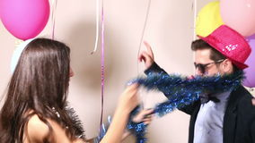 Couple having fun dancing in photo booth. Cute couple having fun dancing in photo booth stock footage