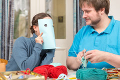 A couple having fun on doing crochet Stock Images