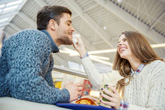 Couple having fun in fast food restaurant Stock Photos