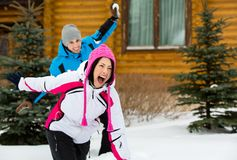 Couple having fun when having snowball fight Stock Photography