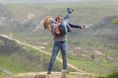 Couple Having Fun on Hill Stock Photo
