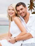 Couple having fun and hugging on beach Stock Image