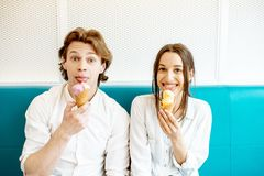 Couple having fun with ice cream stock photography