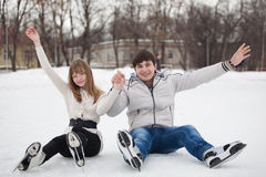 Couple having fun on ice skate rink outdoors. royalty free stock images