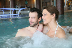 Couple having fun in jacuzzi Stock Images