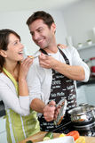 Couple having fun in kitchen Stock Photo