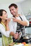 Couple having fun in kitchen Stock Photo