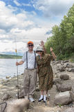 A couple having fun at the lake. Fishing Stock Photos