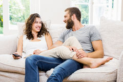 Couple having fun in living room Royalty Free Stock Photo