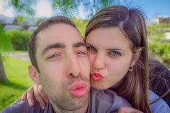 Couple having fun making duckface and taking selfie picture in t Royalty Free Stock Image