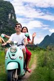 Couple having fun on motorbike around rice fields in China stock images