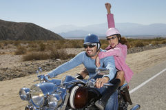 Couple Having Fun On Motorcycle Stock Image
