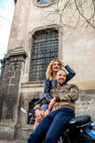 Couple having fun on the motorcycle in the old city Royalty Free Stock Images