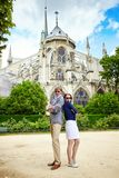 Couple having fun near Notre-Dame Stock Photo