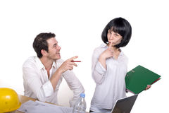 Couple having fun at the office Stock Images