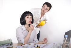 Couple having fun at the office Stock Image