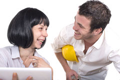Couple having fun at the office Stock Photos