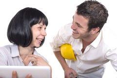 Couple having fun at the office Stock Photos