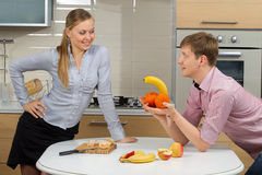 Couple Having Fun On A Kitchen Royalty Free Stock Photo