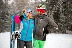 Couple is having fun outdoors in winter mountain Stock Photo