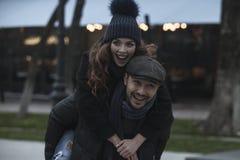 Couple having fun outdoors Royalty Free Stock Image