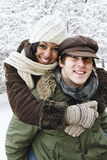 Couple having fun outside in winter Stock Photography