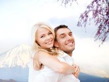 Couple having fun  over fuji mountain in japan Royalty Free Stock Photo