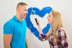 Couple Having Fun While Painting Royalty Free Stock Photo