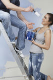 Couple Having Fun While Painting Unrenovated House Royalty Free Stock Image